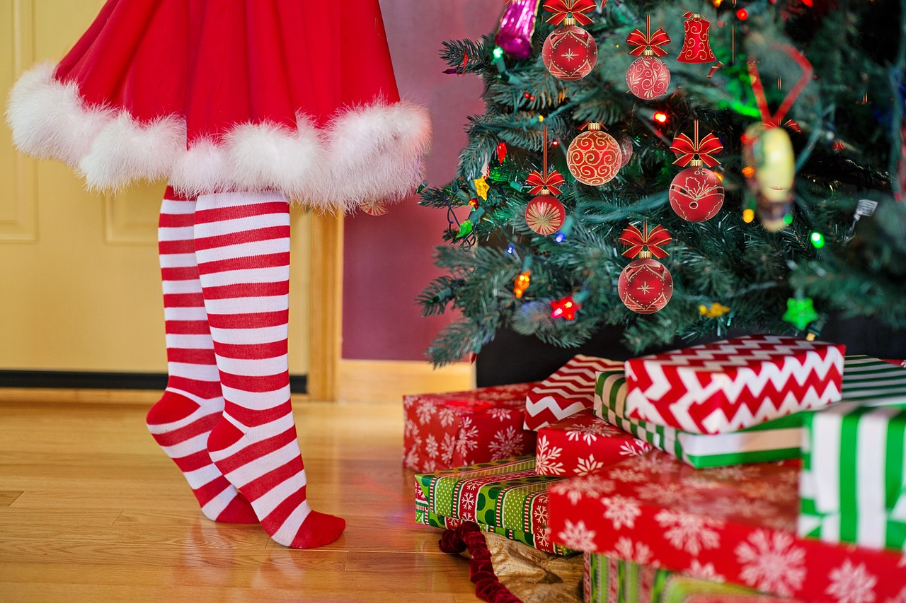 image: mrs claus decorating christmas tree