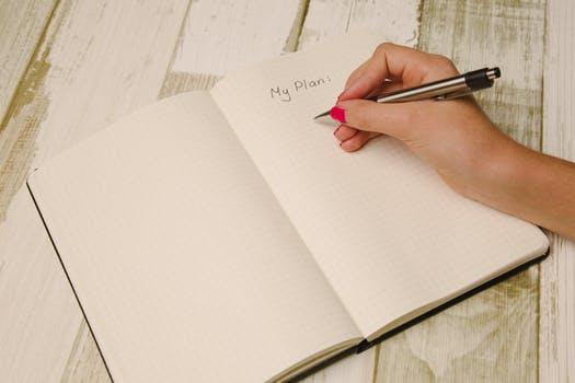 image: woman writing to do list on pad
