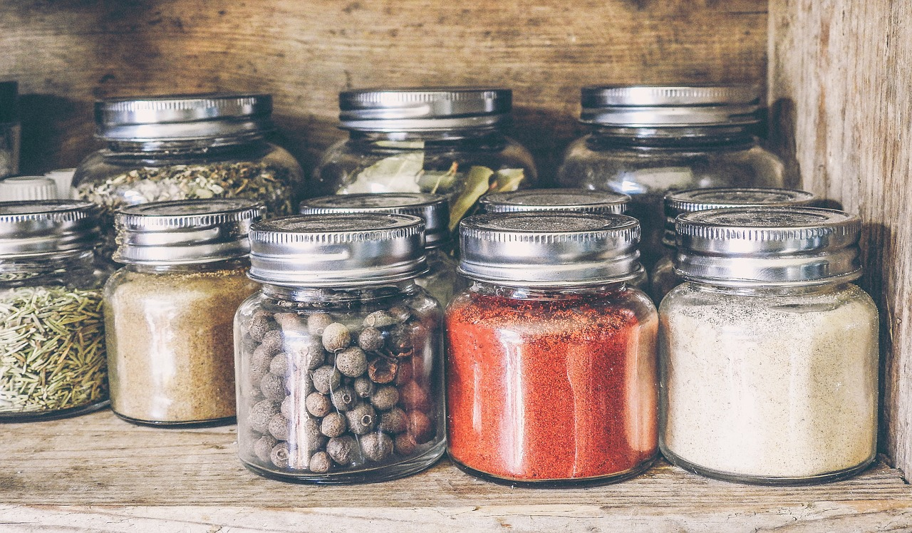 image: jars of spices in pantry