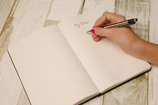 image: woman writing to do list on pad