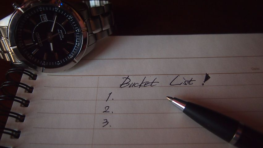 image: bucket list paper pen and watch