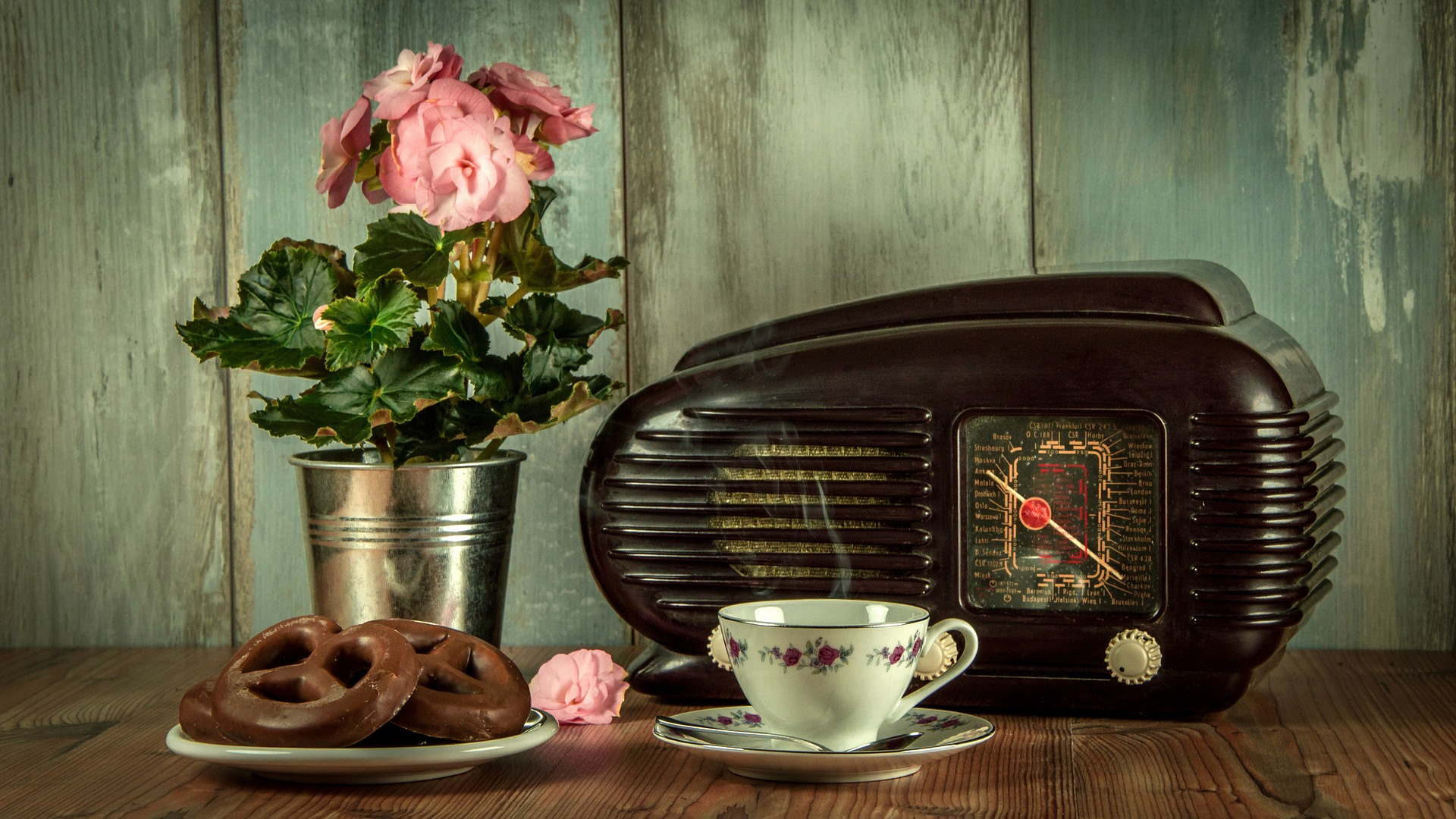 Image: vintage teacup and saucer radio and vase with rose